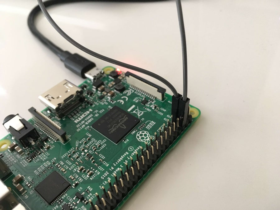 A Raspberry Pi with power button jumper wires connected