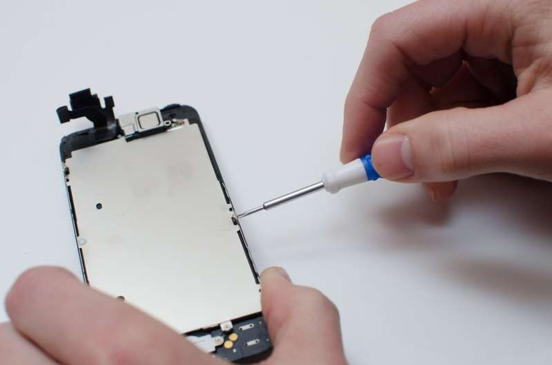 Remove the screws securing the metal plate behind the screen