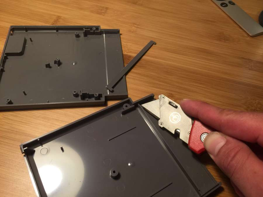 Removing NES cartridge cross supports using a box cutter