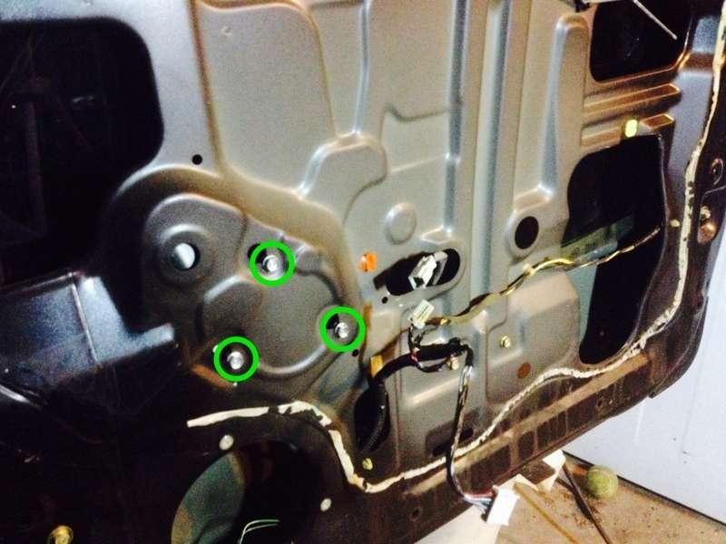 Loosen the 3 window motor bolts