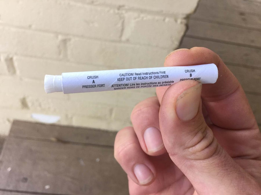 Squeezing a lead paint test applicator
