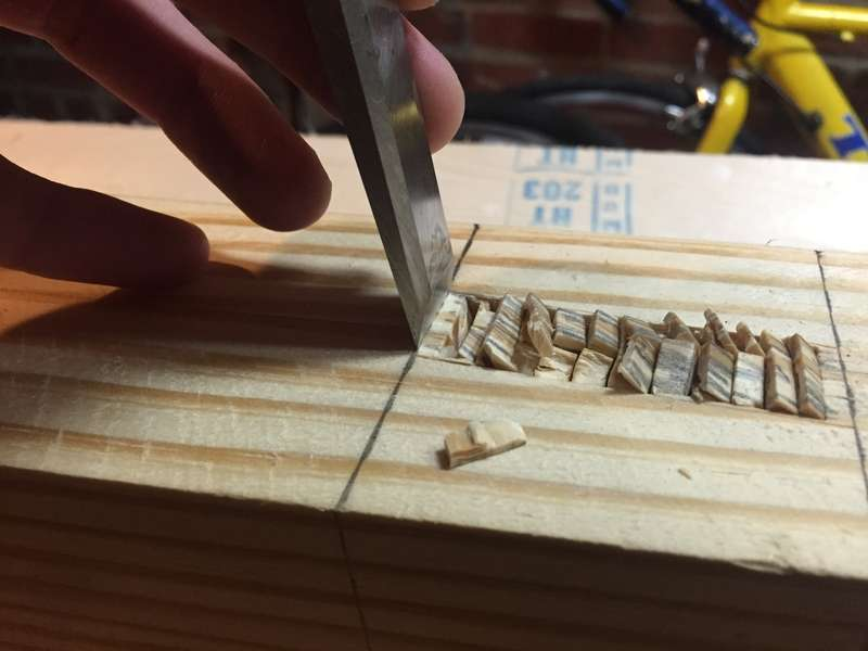 Place the chisel definitively on the line, bevel facing towards your mortise and hit down