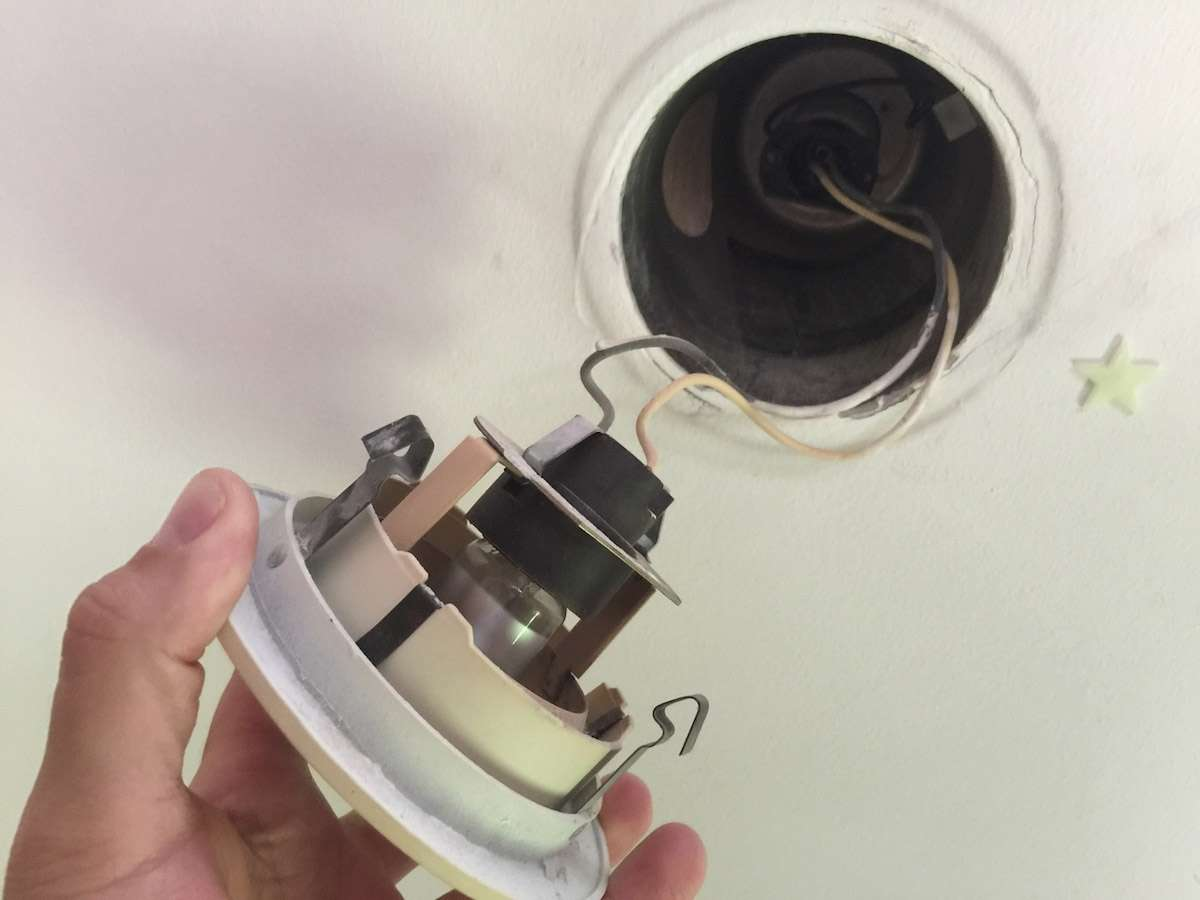 Disassemble the old recessed light fixtures