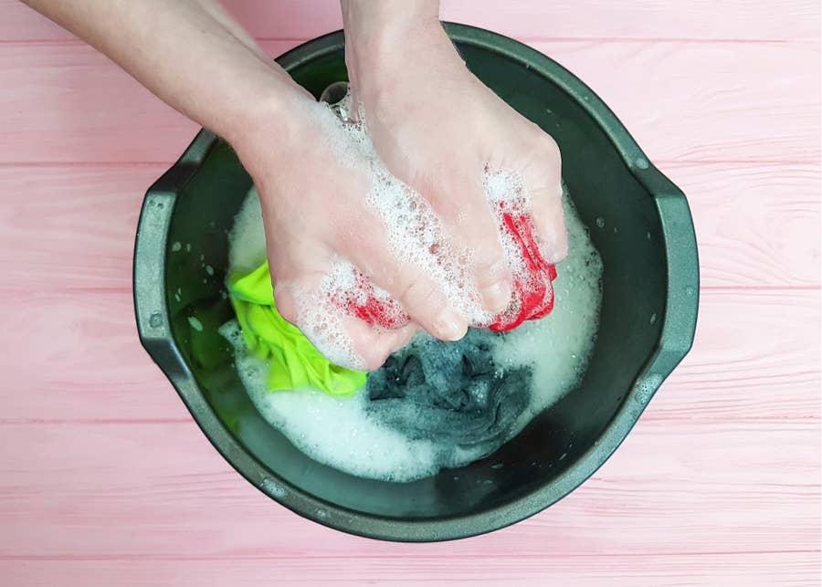 Washing clothes.