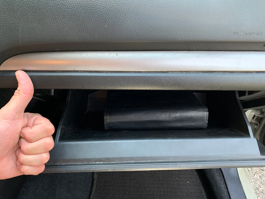 All finished! Thumbs up in front of the glove compartment