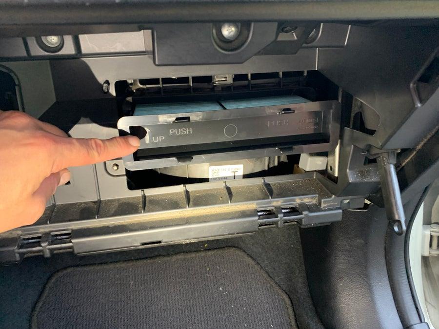 Inserting the new Crosstrek cabin air filter
