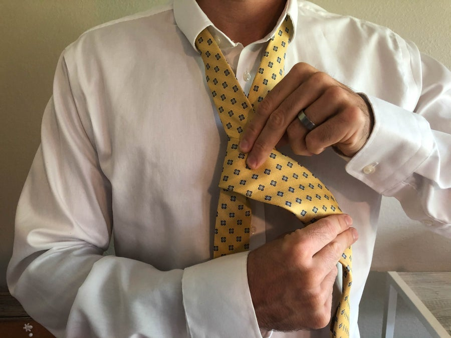 Man Wrapping Tie Pieces