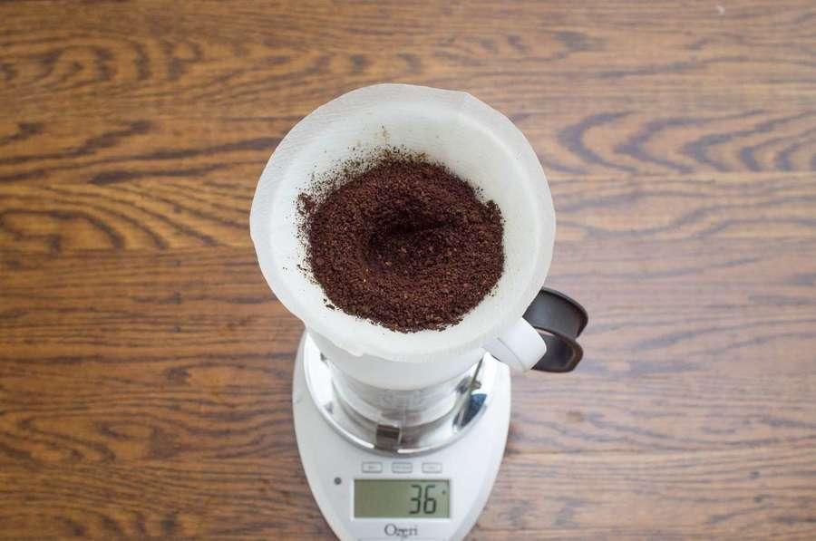 dry coffee grounds in a pourover