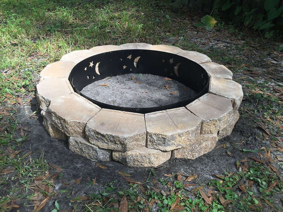 """Walls are complete! The fire pit insert is 9"""" high and each block is only 4"""" high, so as you can see in this photo the lip of the insert protrudes an ..."""