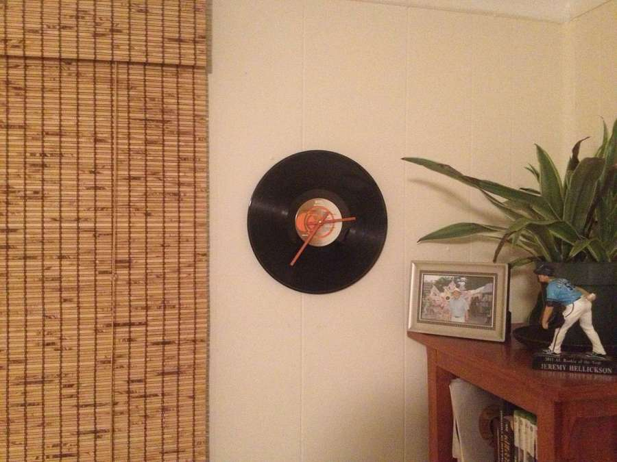 A vinyl record clock hung on the wall