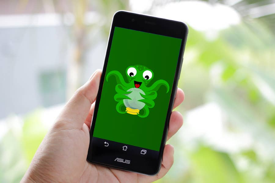 A person holding a phone showing the OctoPrint Anywhere plugin