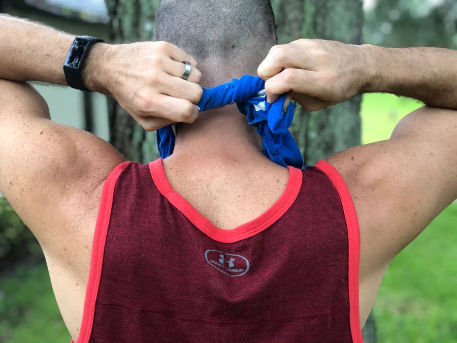 Man tying knot behind head with diy running face mask