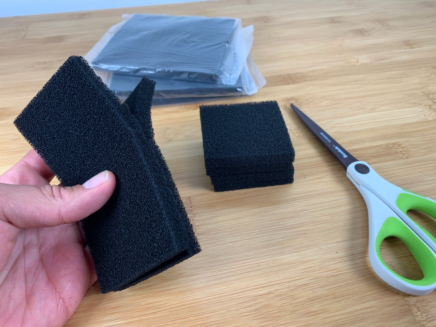 Cutting activated carbon filter with scissors
