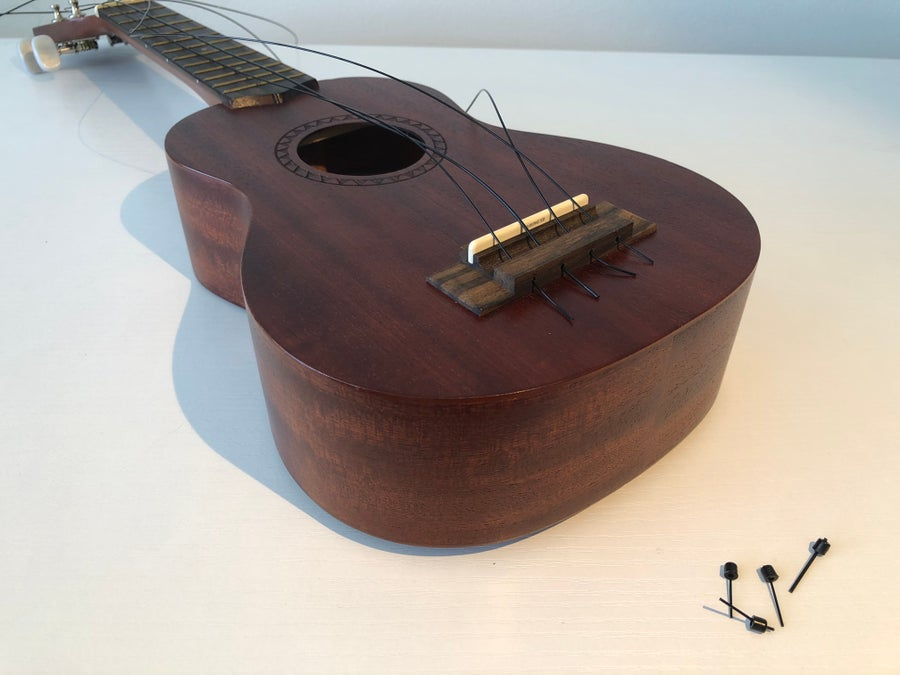 Threading ukulele strings