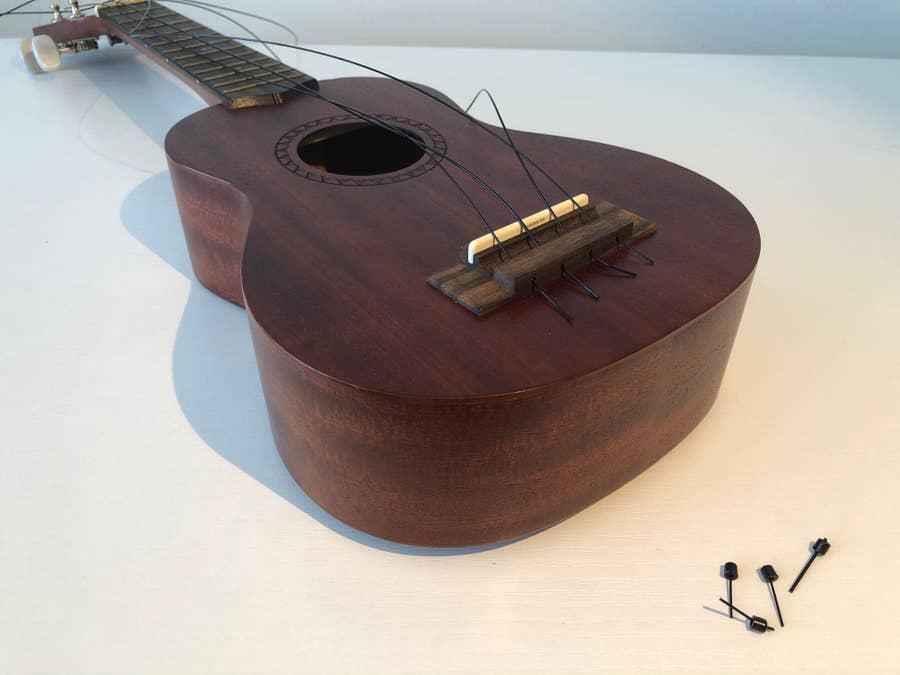 Threading ukulele strings