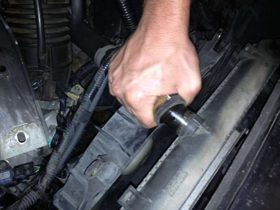 Remove the upper radiator hose (if changing the drivers-side fan)
