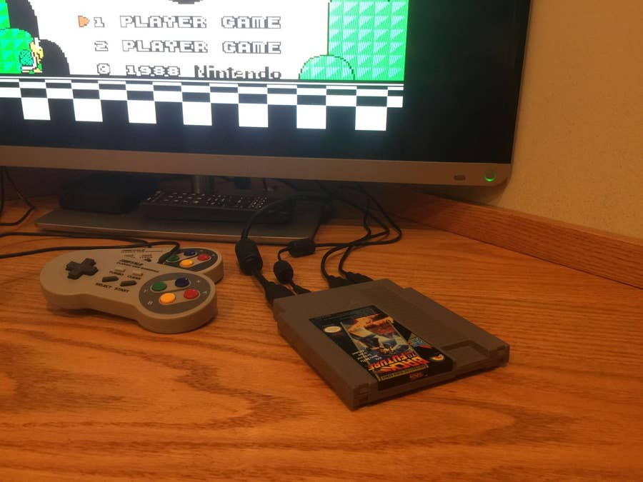 The Pi Cart connected to a TV with two USB controllers