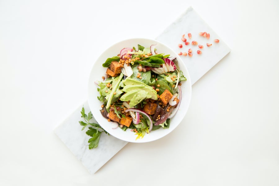 Individual salad bowl on a white background