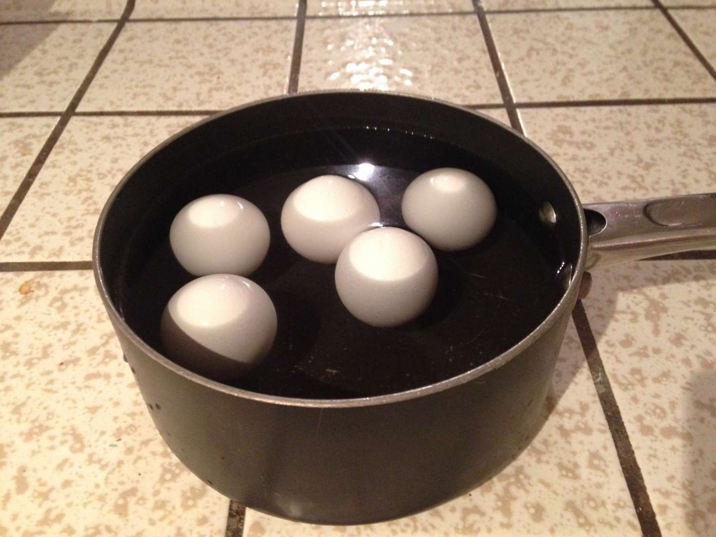 Place the eggs in a pot of water