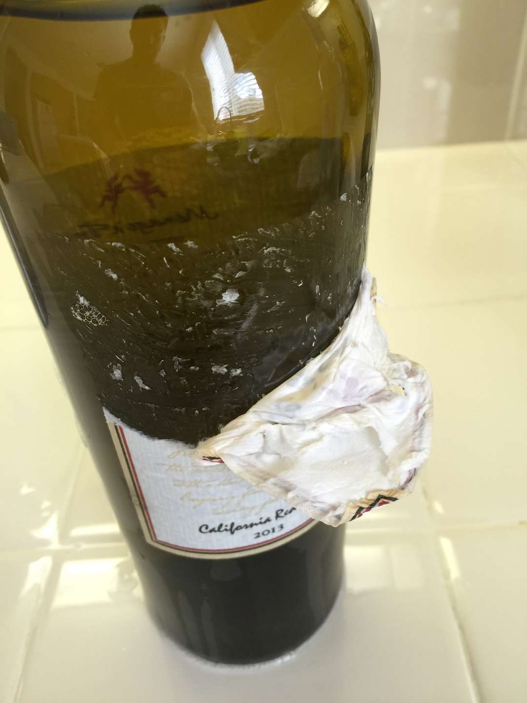 Remove the label from the wine bottle