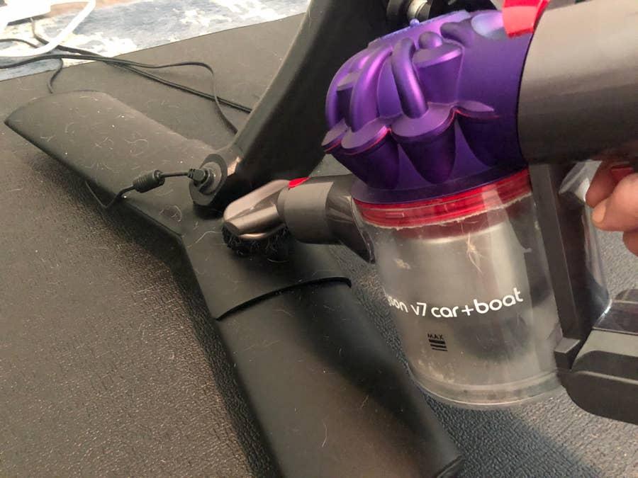 Vacuum any dust or debris before wiping down the Peloton Bike