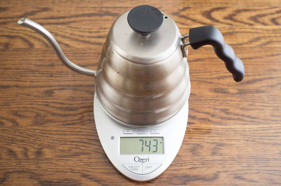 weighing a gooseneck kettle on a scale
