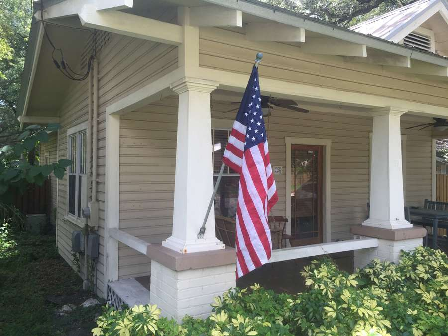 American flag on a tan bungalow