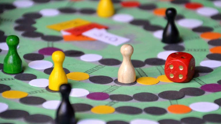 Board game being played