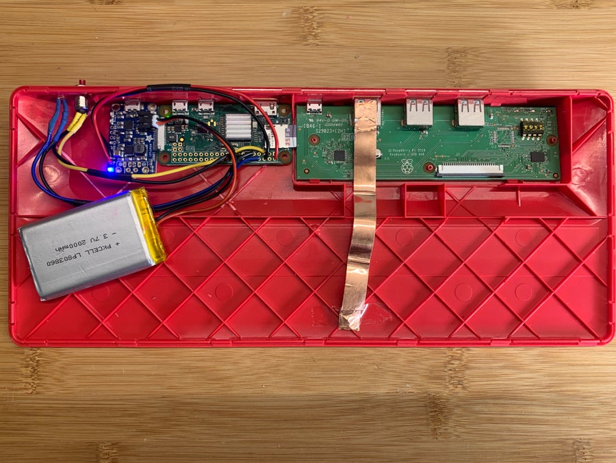 The keyboard's internals, showing battery placement