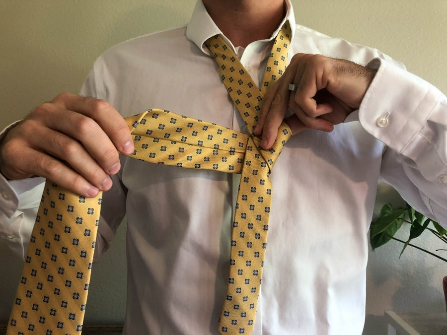 Man Tying a Tie Wrapping Pieces