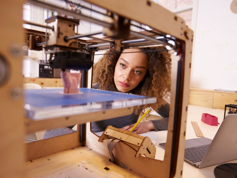 Woman Looking at Budget 3D Printer
