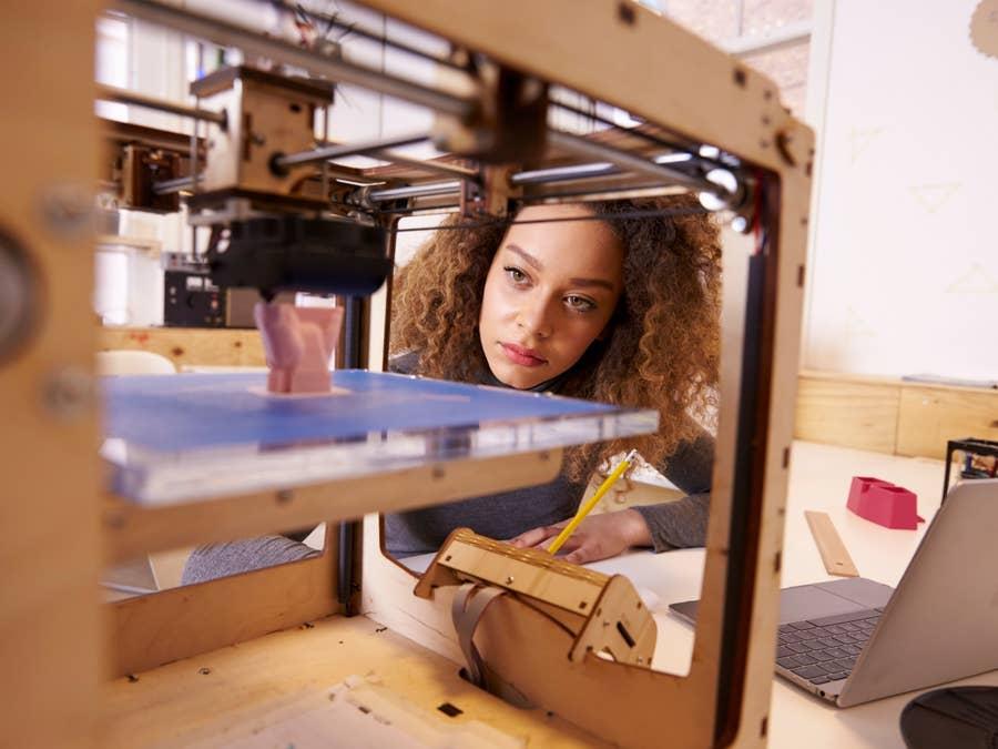 Woman Looking at Budget 3D Printer