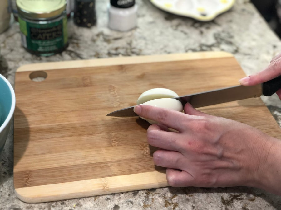 Slicing egg in half