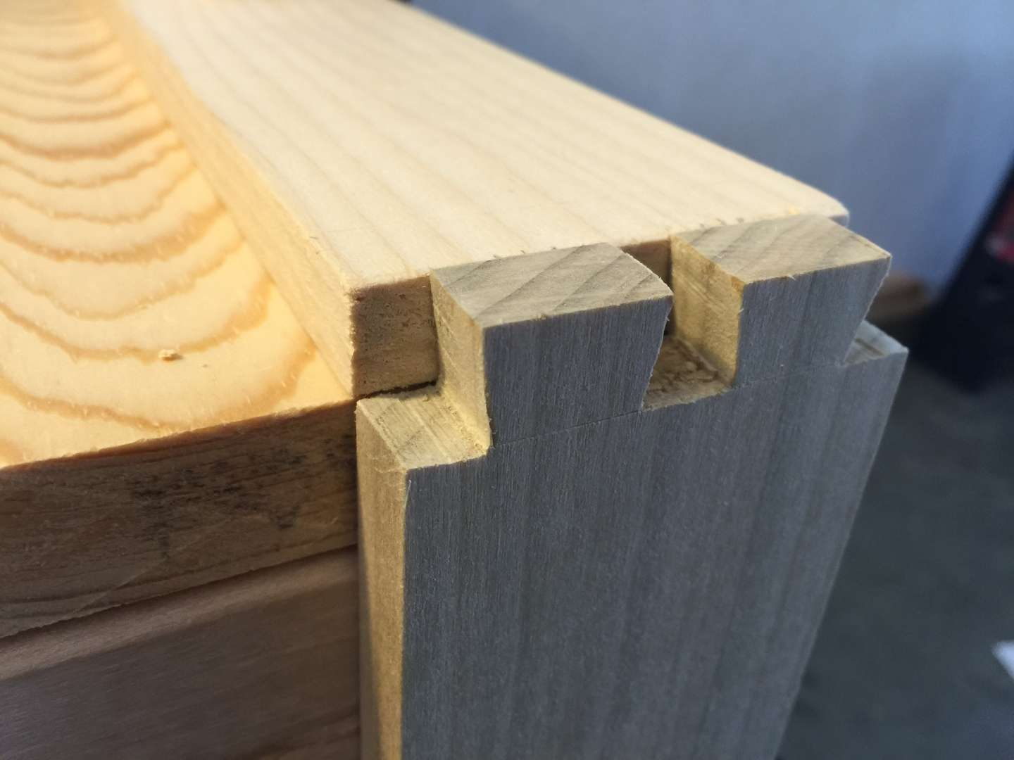 With your marking knife, trace the edges of your tail board onto the end of the pin board