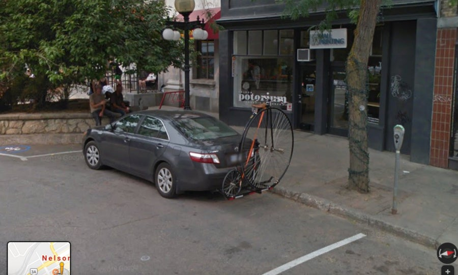 penny-farthing attached to car