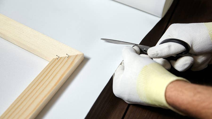 Cutting canvas.