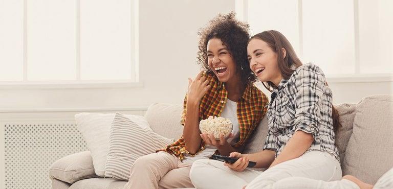 Two Women Watching Concert