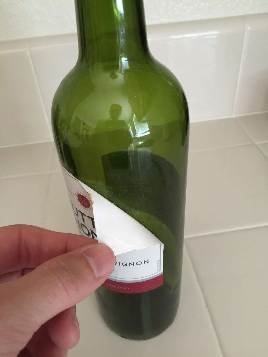 Use that corner to peel away the rest of the label