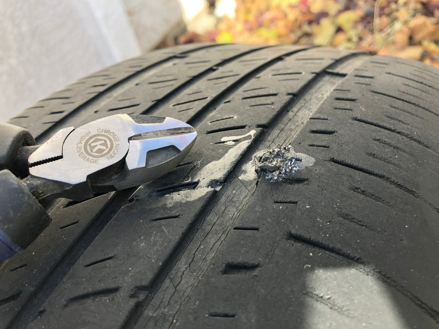Cut away the excess string plug from your punctured tire.