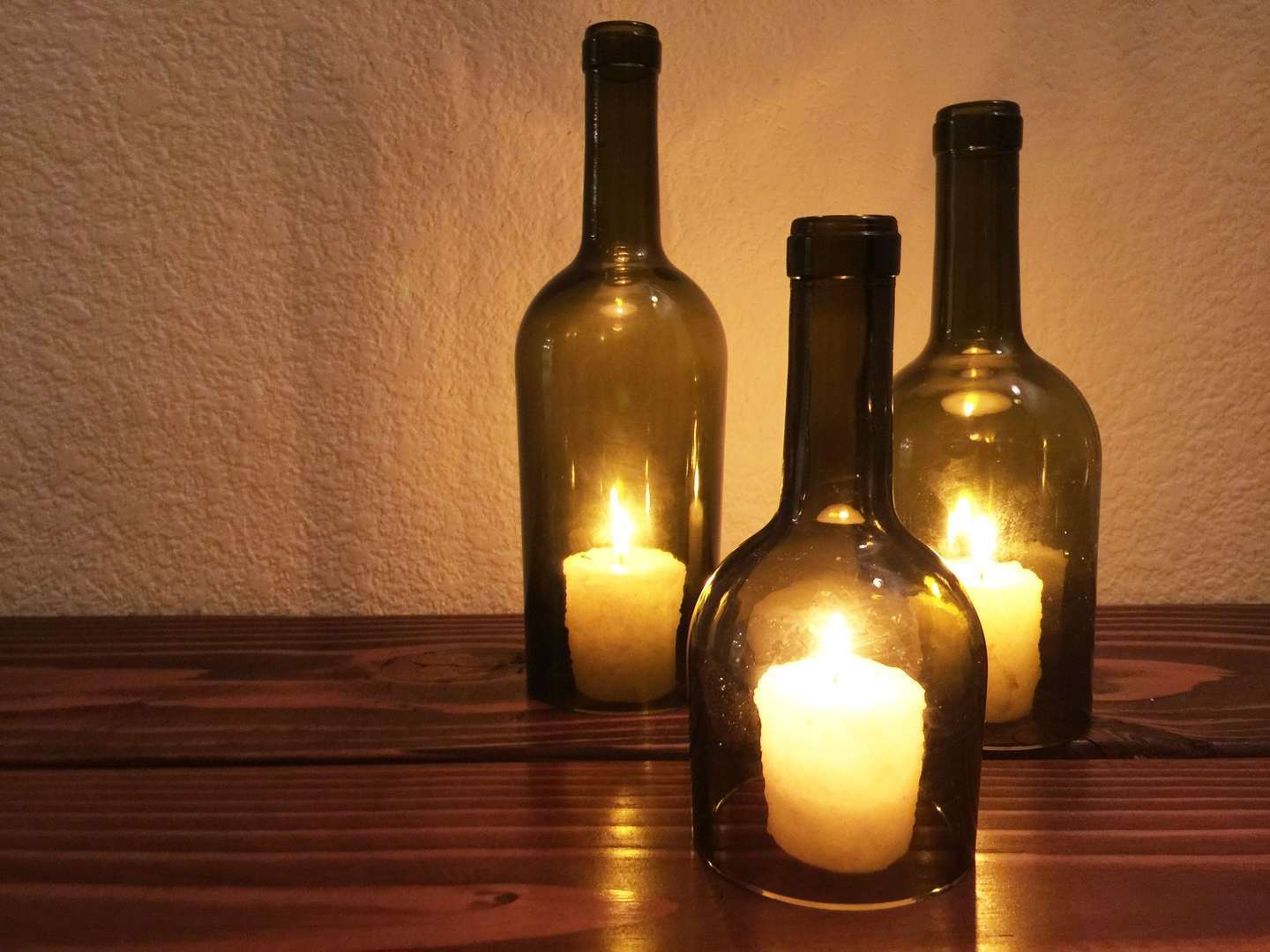 Turn a wine bottle into a candle hurricane lantern