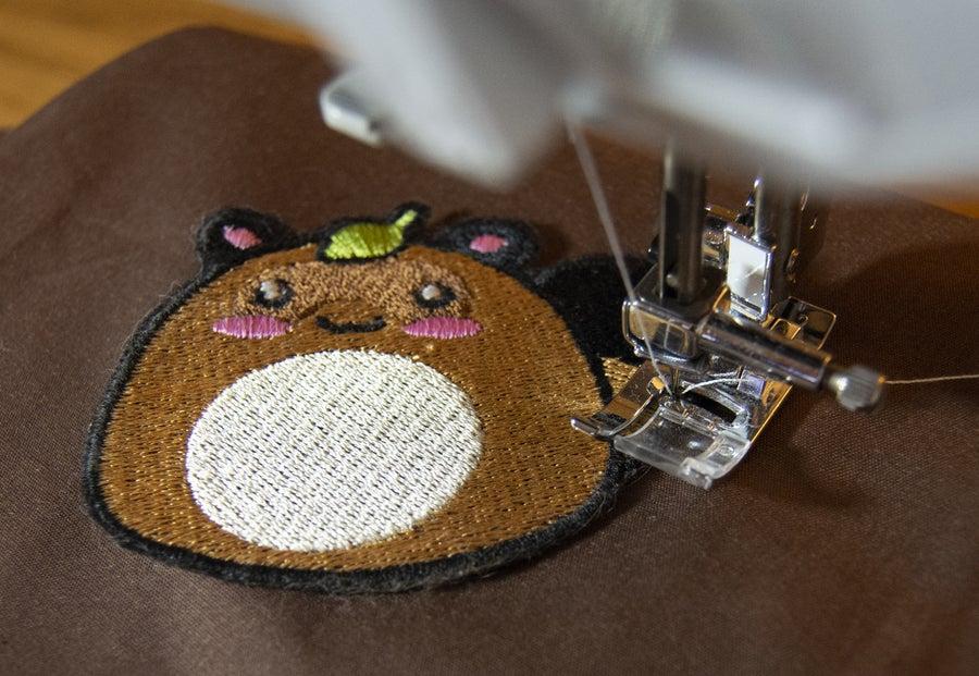Sew on patch using machine