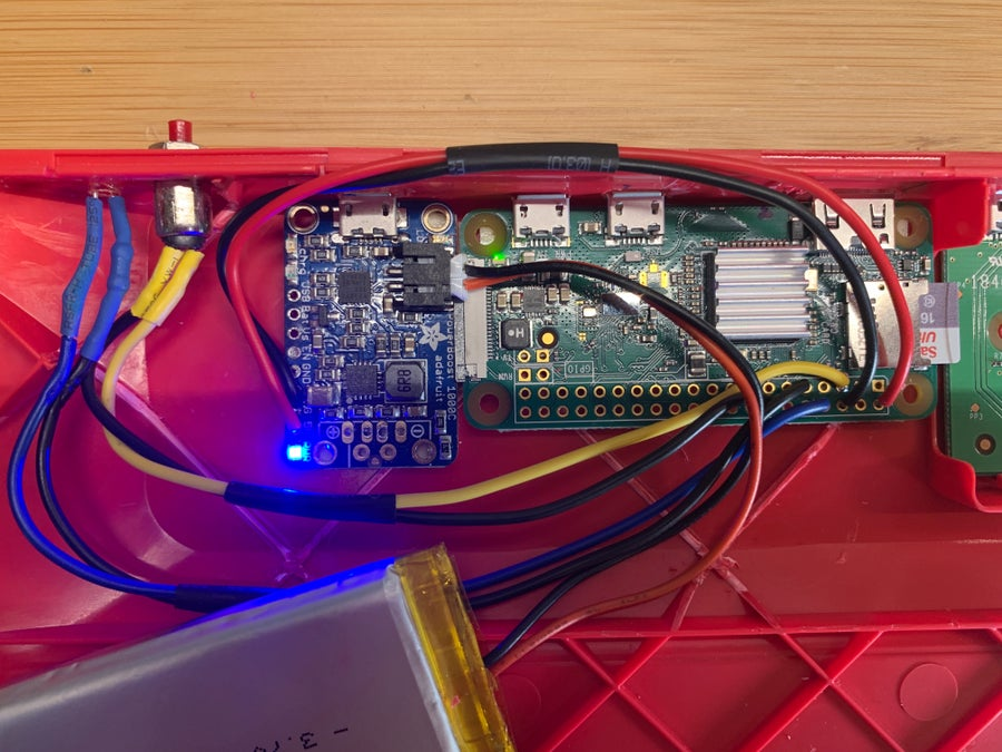 The PowerBoost 1000C and LiPo battery powering the Pi and keyboard circuitry.