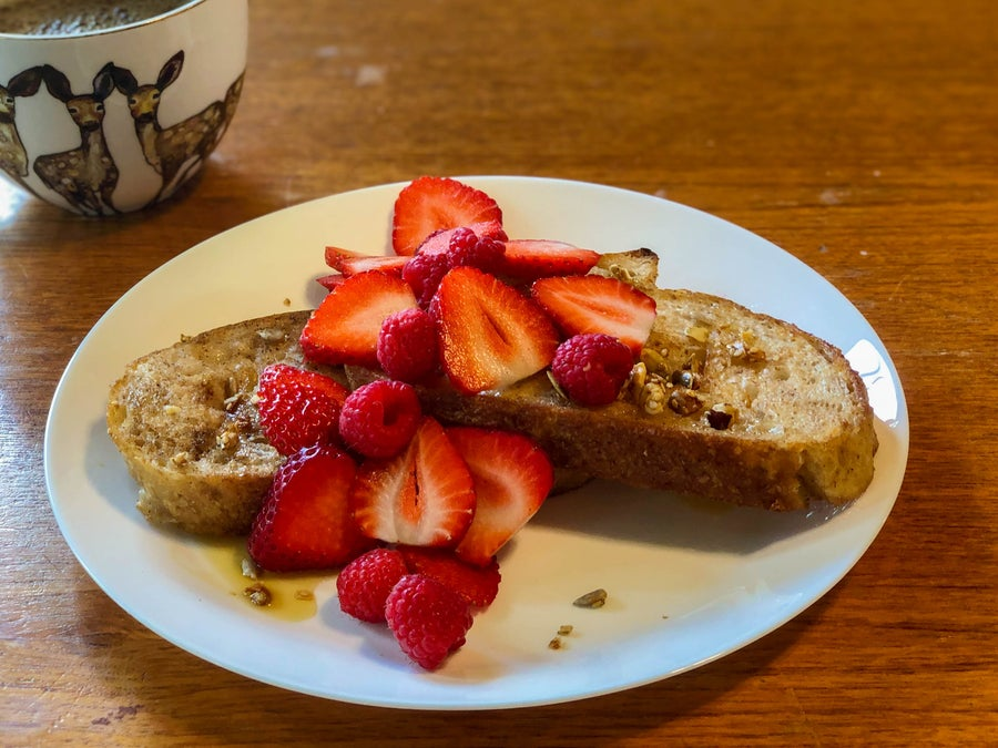 French Toast with strawberries and cup of coffee