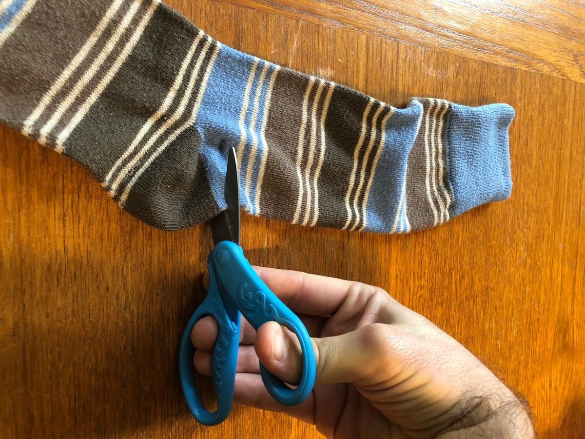 Scissors Cutting Sock in Half