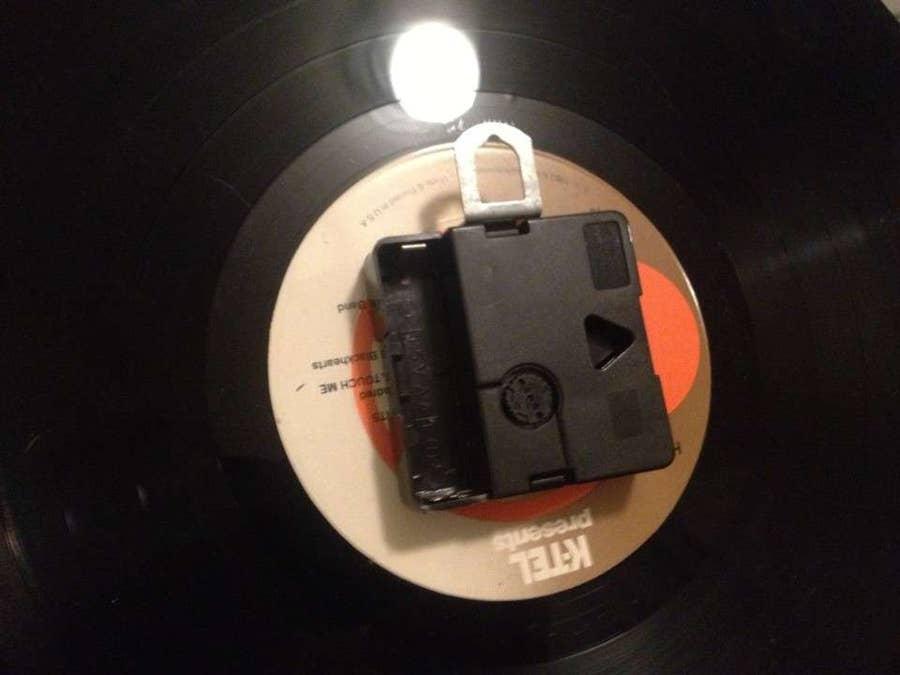 Attach the clock movement to the record