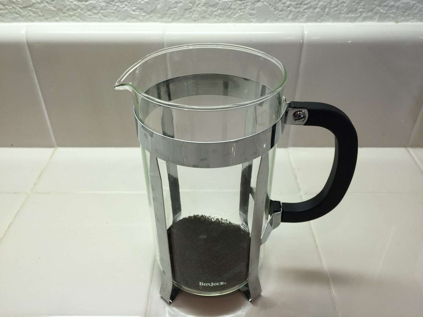 french press filled with coffee grounds