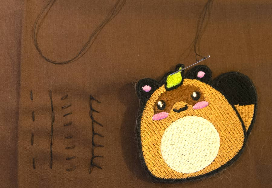 Sew on patch by hand