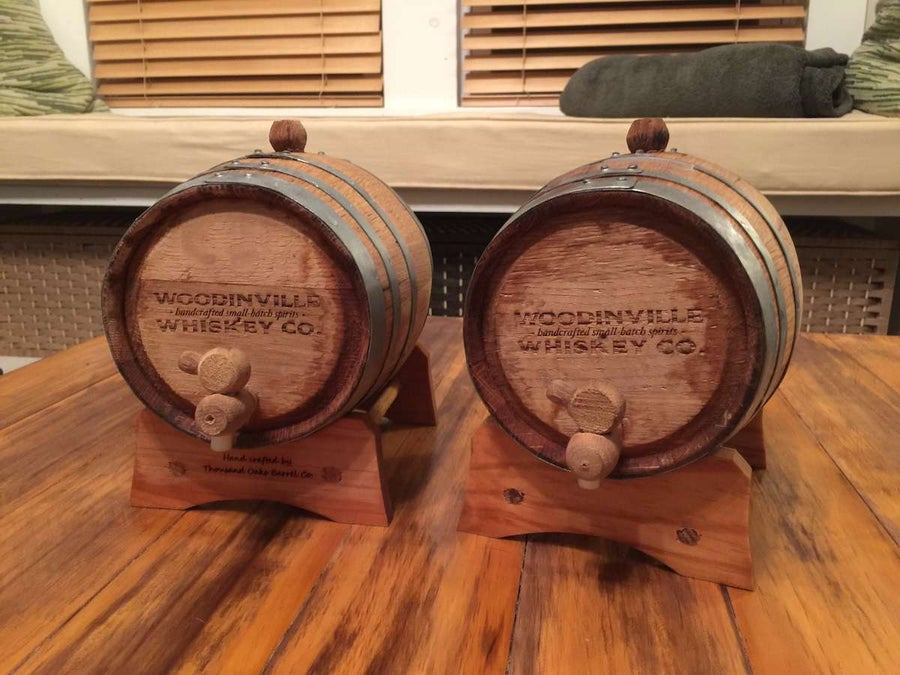Two wooden casks sitting on a table