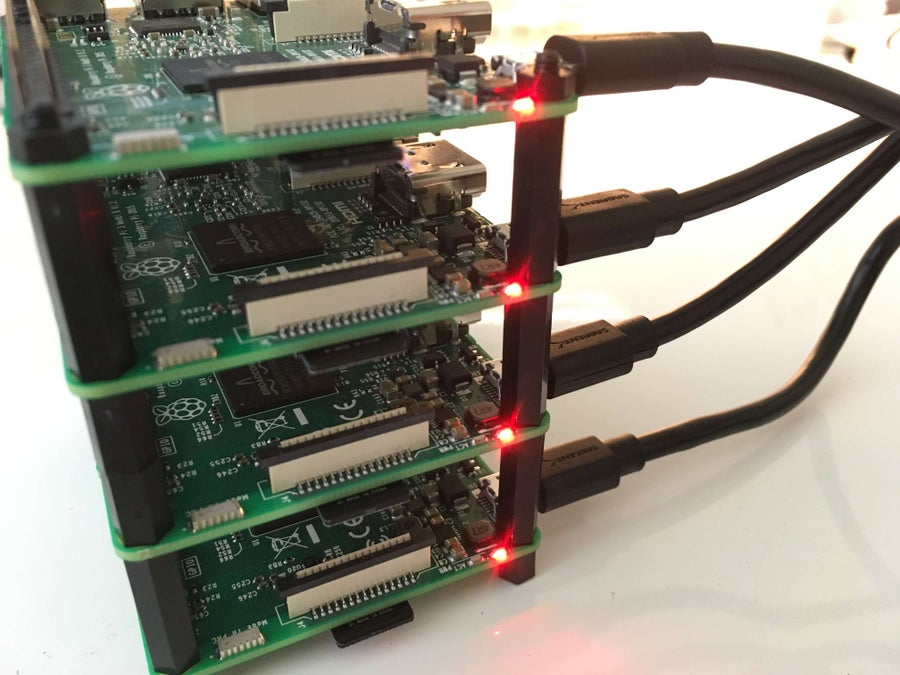 Four Raspberry Pis connected in cluster and powered on