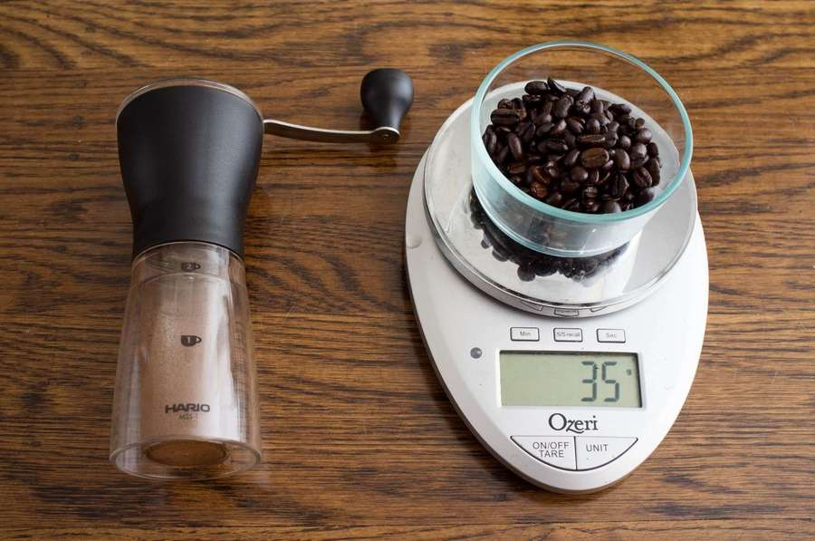 weighing coffee beans to grind with the hario mini mill